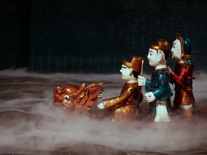 Vietnamese Water Puppets in a boat