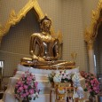 You're looking at the world's largest solid gold statue. This Golden Buddha image sits in the upper room of a tall structure inside Wat Traimit, a temple in Bangkok's Chinat